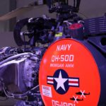 A katonai felhasználást mutatja, hogy a kiállításon egy ilyen, valódi - pilóta nélküli - bombázó drón helikoptert is bemutatnak, amely évtizedekig volt hadrendben.
